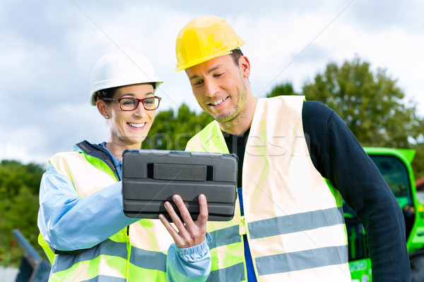 builders with blueprint on construction site Stock photo © Kzenon
