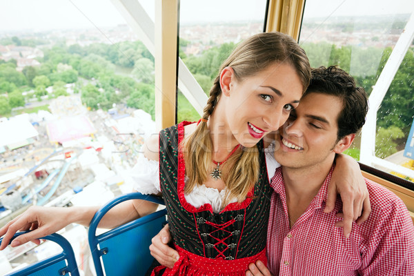 Carnival couple - Ferris wheel Stock photo © Kzenon