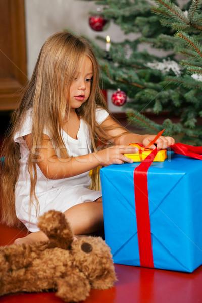 Child opening Christmas presents Stock photo © Kzenon
