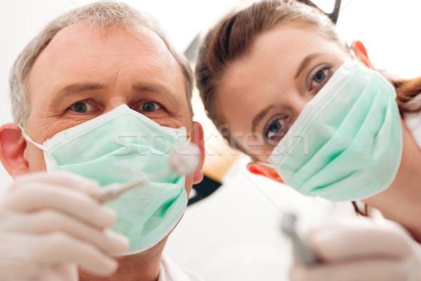 Dentist, Assistant and drill in a treatment Stock photo © Kzenon