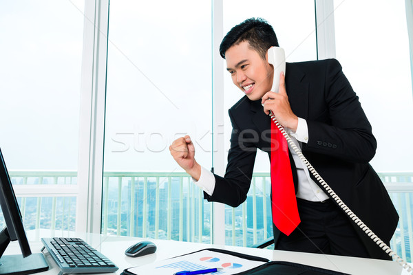 Asian businessman working in office Stock photo © Kzenon
