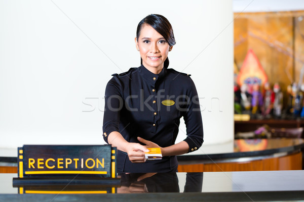 Hotel receptionist portret vrouw asian welkom Stockfoto © Kzenon