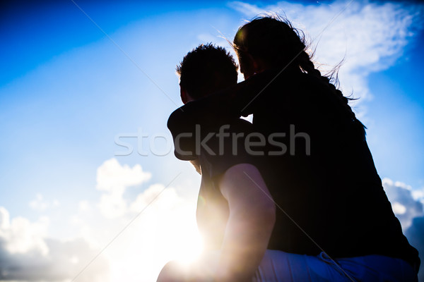Couple enjoying romantic sunset on beach Stock photo © Kzenon