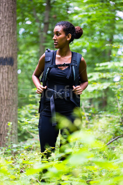 African young woman hiking on forest track  Stock photo © Kzenon