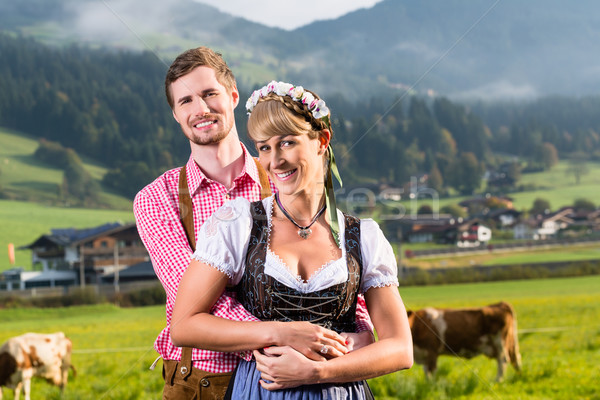 Alpine cattle farmers on mountain meadow Stock photo © Kzenon
