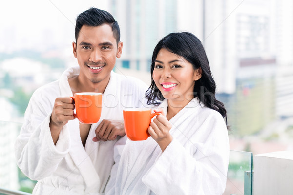 ázsiai pár reggel elöl városkép iszik Stock fotó © Kzenon