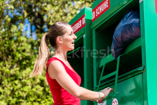 Woman at clothes recycling skip  Stock photo © Kzenon