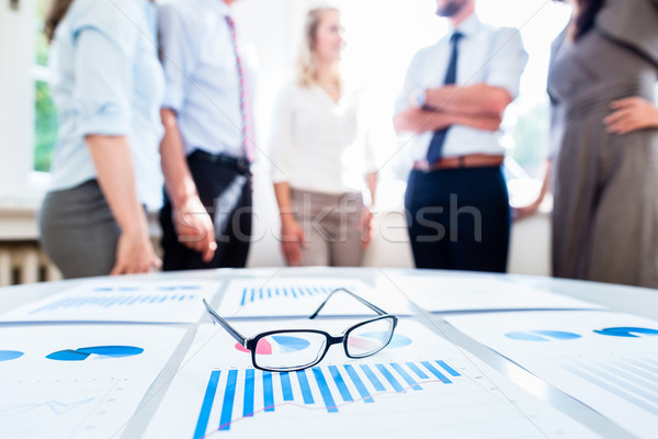 Business people in office with financial data Stock photo © Kzenon