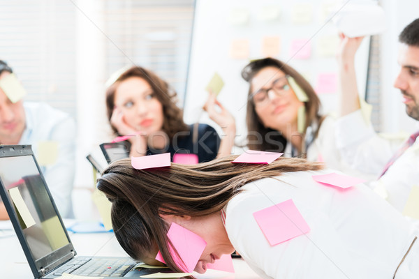 Women and men in office being tired and frustrated Stock photo © Kzenon