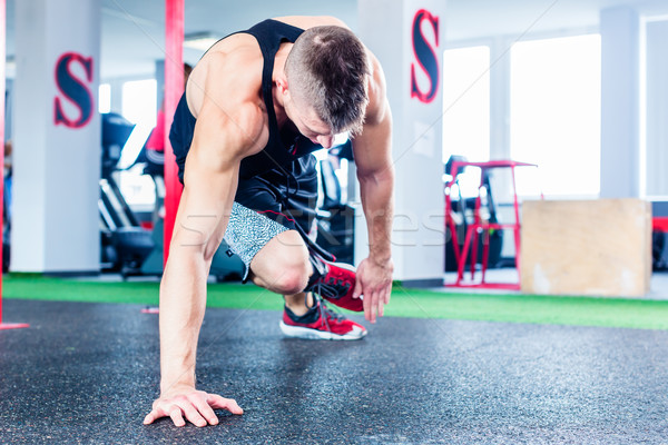Man doing push-up in sport fitness gym Stock photo © Kzenon