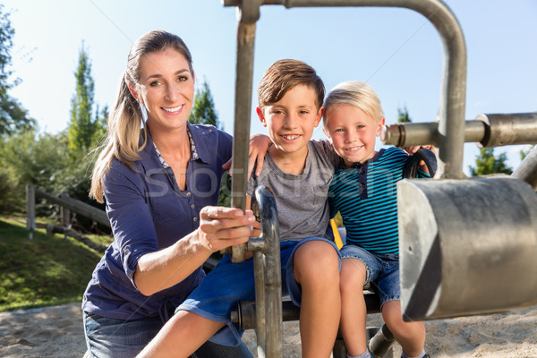 Two brothers playing together at toy excavator on playground  Stock photo © Kzenon