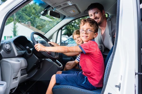 Family having test drive of new car at dealership Stock photo © Kzenon