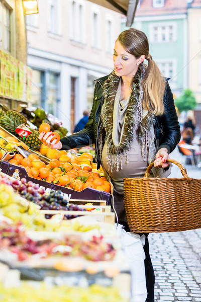 Pregnant woman shopping groceries on farmers market Stock photo © Kzenon