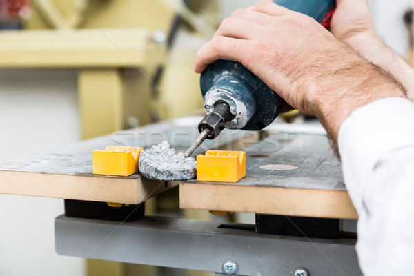 Stonemason shaping ornament with pneumatic chisel Stock photo © Kzenon