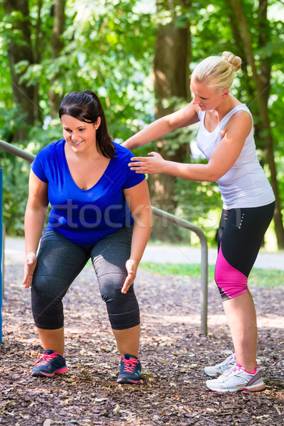Thin and overweight woman workout together  Stock photo © Kzenon