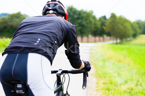 Uomo gara bike sport ciclismo giù Foto d'archivio © Kzenon