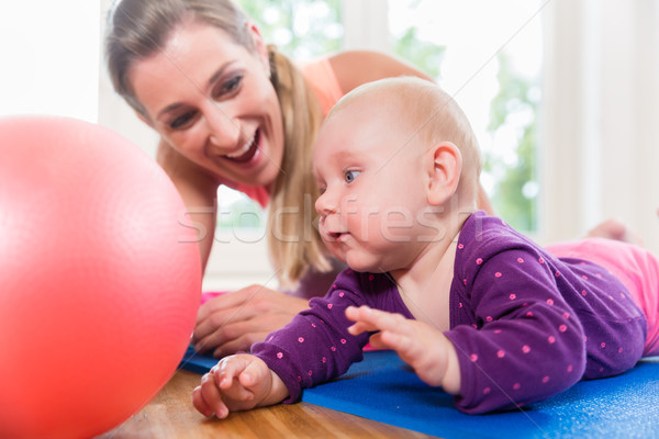 Mom and her baby practicing to crawl in mother and child course Stock photo © Kzenon