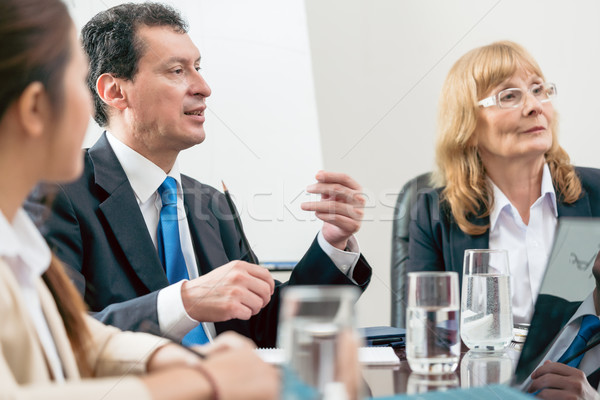 Expert businessman sharing his view during a decision-making mee Stock photo © Kzenon