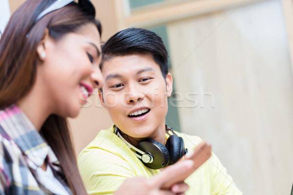 Curioso homem olhando telefone móvel usado colega Foto stock © Kzenon