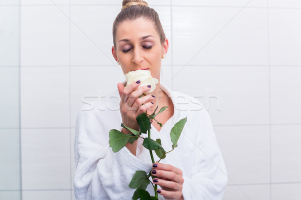 Woman in bathrobe with white rose Stock photo © Kzenon