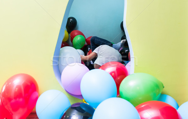 Children playing with balloons during playtime in interior of ki Stock photo © Kzenon