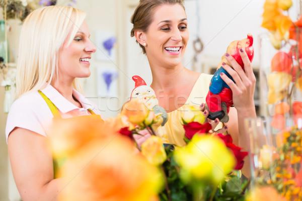 Women in the flower store buying roses Stock photo © Kzenon