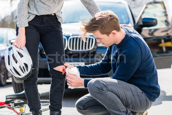 Young driver using a sterile bandage from his first aid kit Stock photo © Kzenon