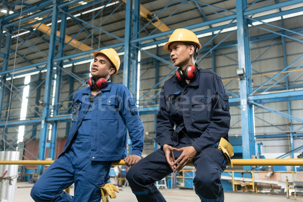 Rear view of two blue-collar workers during break Stock photo © Kzenon