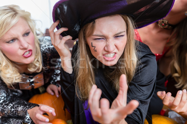 Portrait of a funny young woman wearing witch costume during Halloween Stock photo © Kzenon