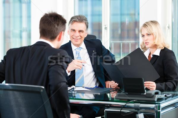 Negócio moço sessão entrevista de emprego escritório homem Foto stock © Kzenon