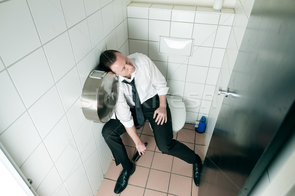 Young sleeping drunk man on the toilette Stock photo © Kzenon
