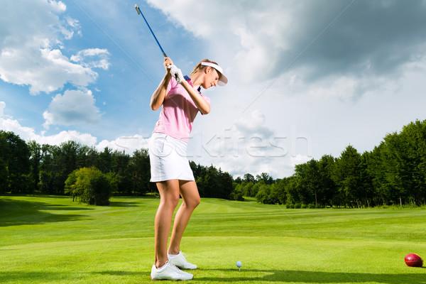 Genç kadın golf salıncak kadın Stok fotoğraf © Kzenon