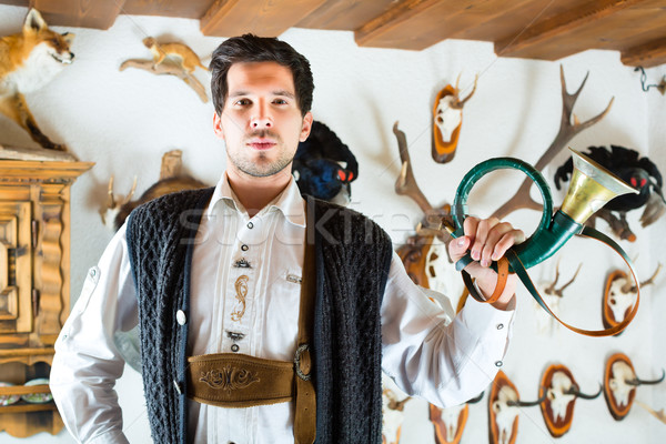 Hunter in a mountain hut in alp mountains Stock photo © Kzenon