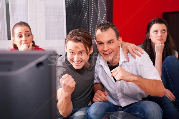 Friends watching TV Stock photo © Kzenon