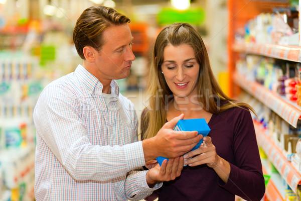 couple in supermarket choosing groceries Stock photo © Kzenon