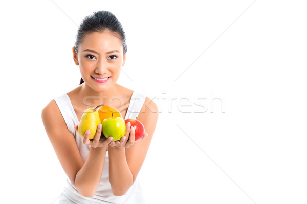 Asian woman offering healthy fruits  Stock photo © Kzenon