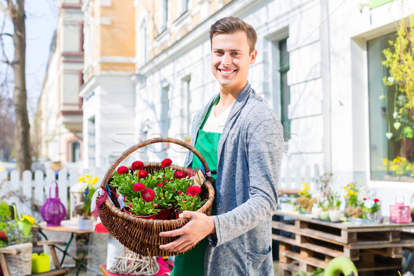 Stock photo: Florist with flower basket at shop selling