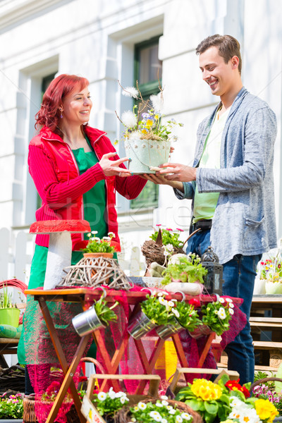 Stock photo: Costumer buying flower in flower shop