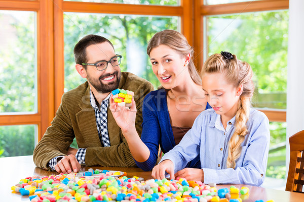 Family spending quality time playing together Stock photo © Kzenon