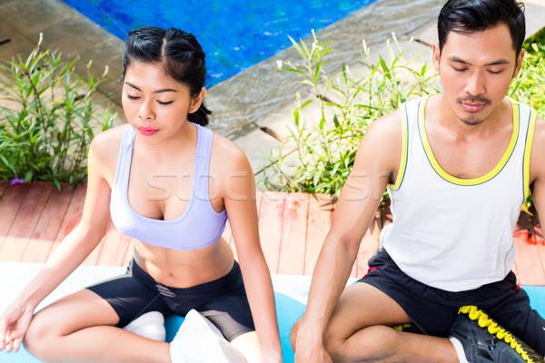 Asian couple in lotus seat yoga pose exercise Stock photo © Kzenon