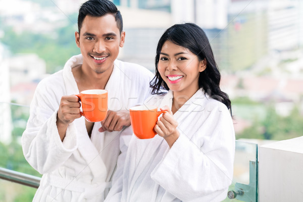 Asian couple in morning front of city skyline Stock photo © Kzenon