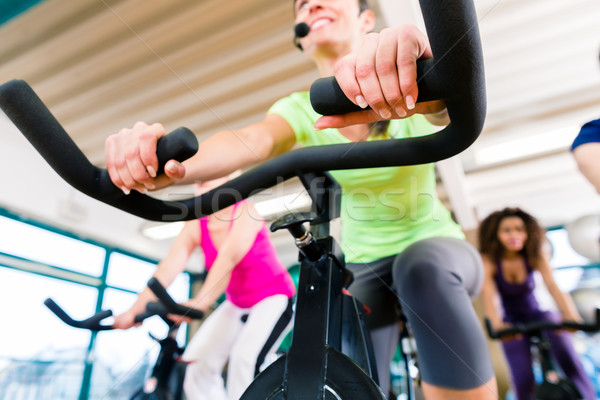 Woman at Fitness Spinning on bike in gym Stock photo © Kzenon