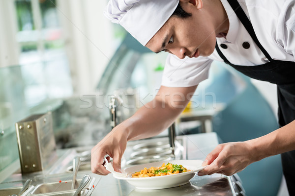 Gourmet chef plating up a dish of food Stock photo © Kzenon