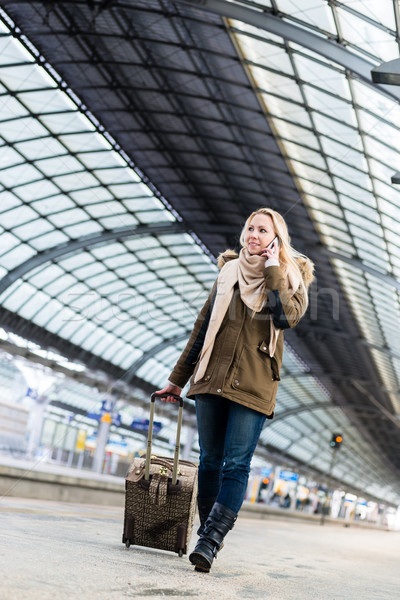 Woman with her luggage walking along the platform in train stati Stock photo © Kzenon