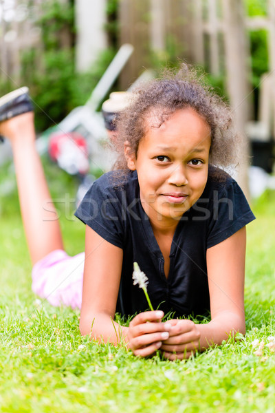 Nero ragazza erba lama prato estate Foto d'archivio © Kzenon