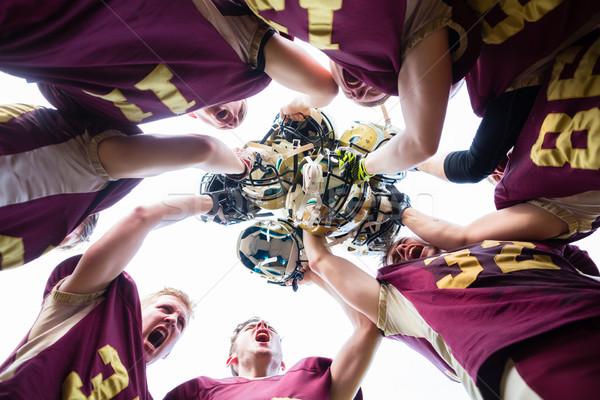 Overwinning amerikaanse voetbal team spelers sport Stockfoto © Kzenon