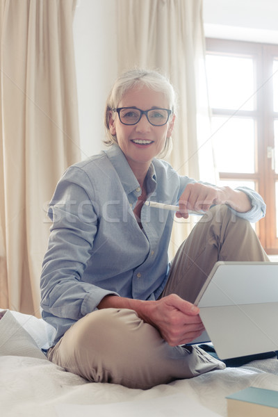 Senior woman freelancer in her study with computer Stock photo © Kzenon