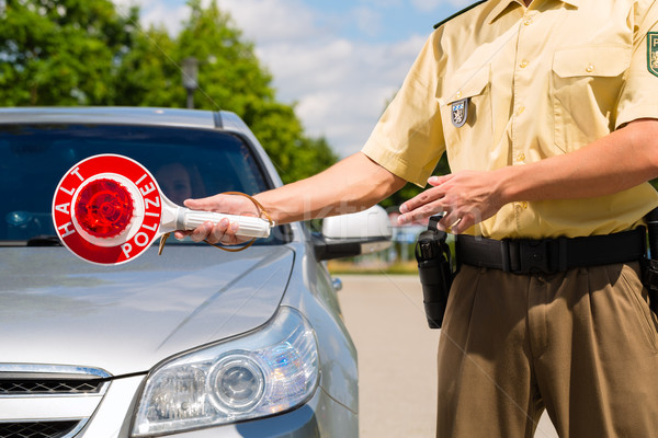 Police - policeman or cop stop car Stock photo © Kzenon