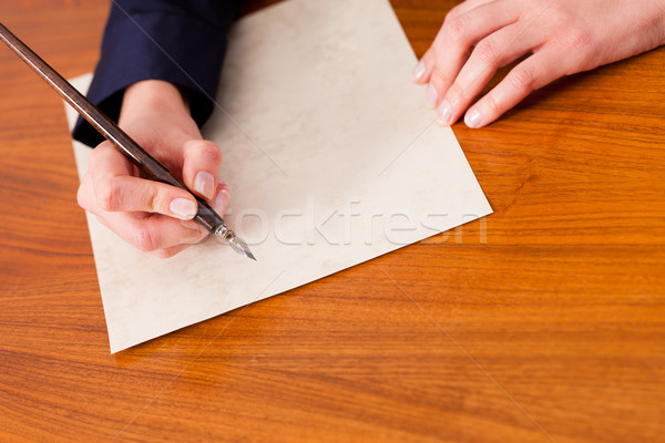 Woman writing a letter with pen and ink Stock photo © Kzenon