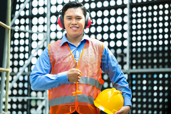 Asian Indonesian construction worker on building site Stock photo © Kzenon